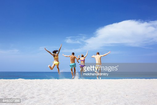 Happy friends on lonely beach : Foto de stock