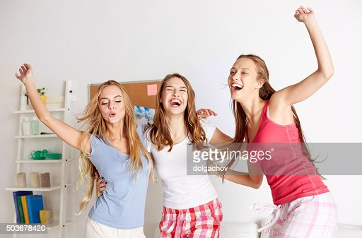 happy friends or teen girls having fun at home : Stock Photo