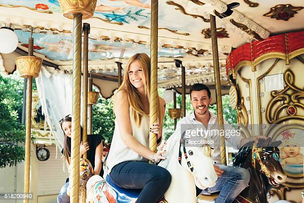 Happy Friends Playing On Merry-Go-Round