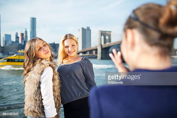 Happy friends posing for photos in New York City