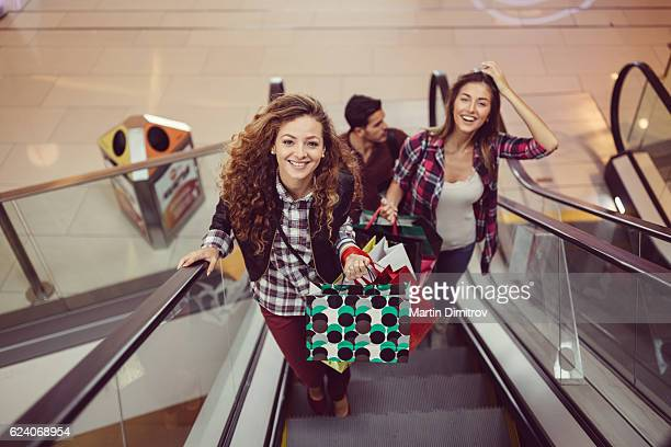Happy friends shopping in the mall