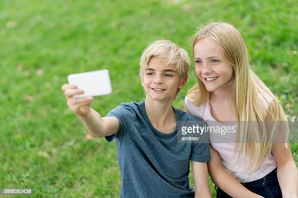 Happy friends taking a selfie at the park