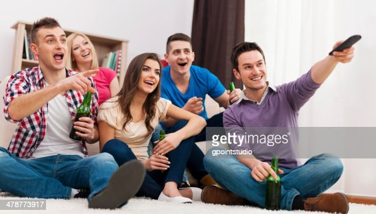 happy friends watching funny movie at home stock photo