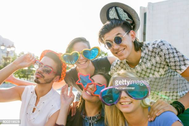 Happy friends with funny sunglasses having fun together.