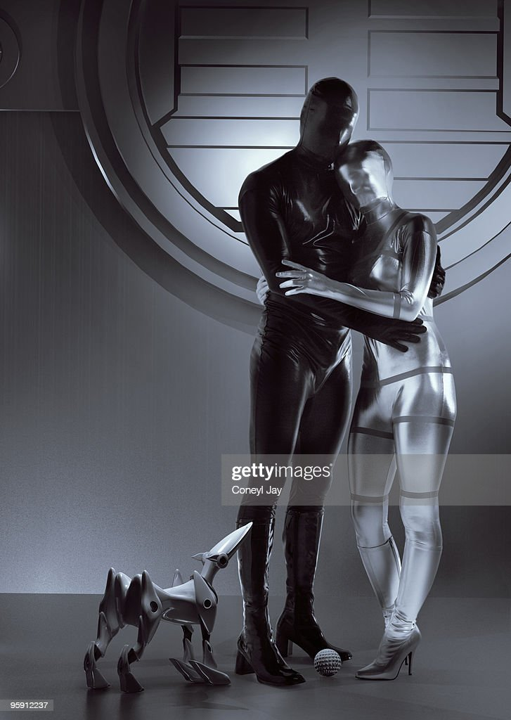 Happy futuristic couple and robot dog : Stock Photo