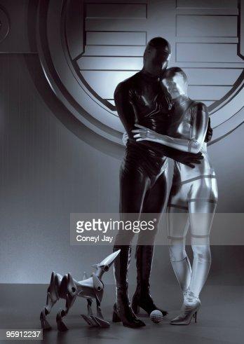 Happy futuristic couple and robot dog : Stock Photo