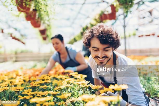 Happy gardener looking at the flowers