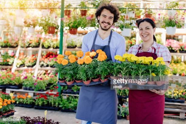 Happy gardeners with full flower trays