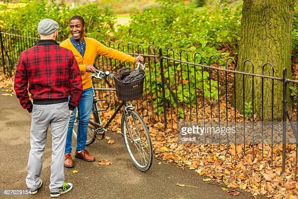 Happy Gay Men Meeting in a Park