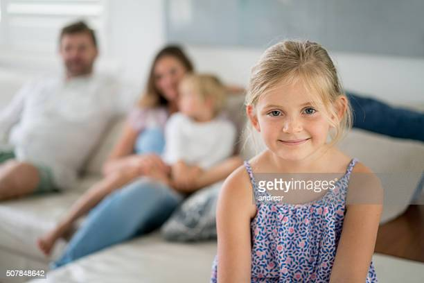 Happy girl at home with her family