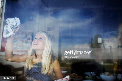 Happy girl cleaning window : Stock Photo