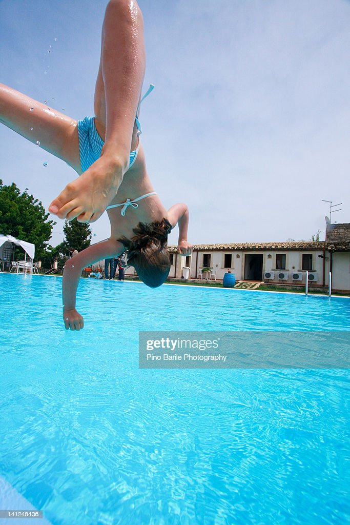 Happy Girl Diving Into Swimming Pool Stock Photo Getty