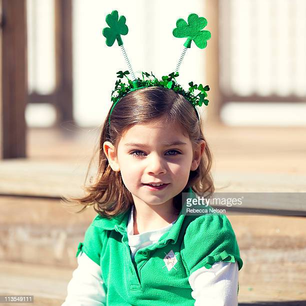 Happy girl dressed up for St. Patrick's Day