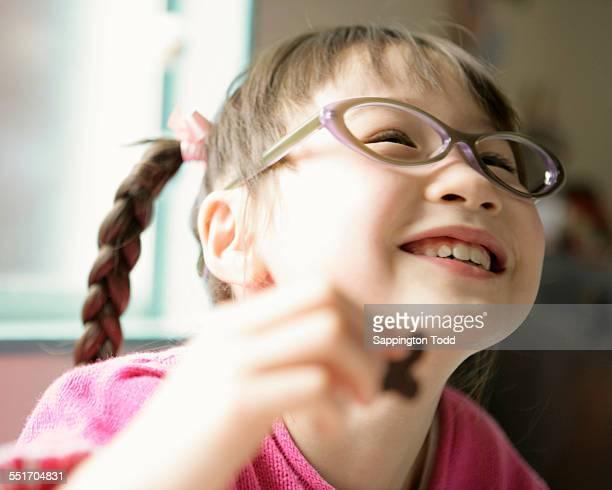 Happy Girl Eating Cookies