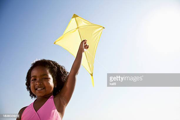 Happy girl flying a kite