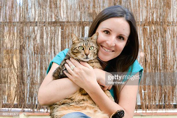 Happy girl holding with love a big beautiful cat