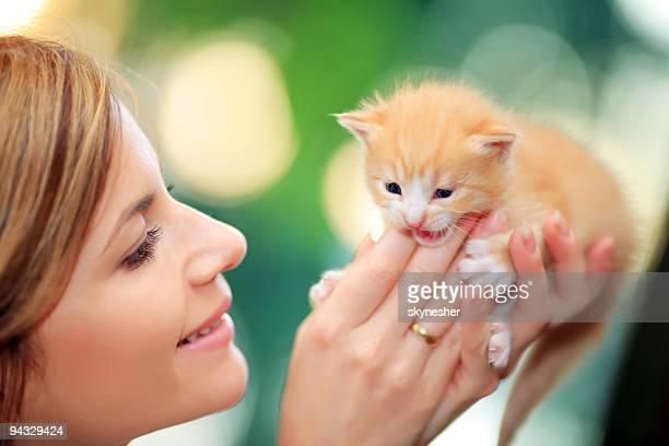 Happy girl hugging her cute cat.