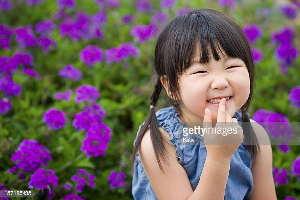 Happy Girl in Flower Garden
