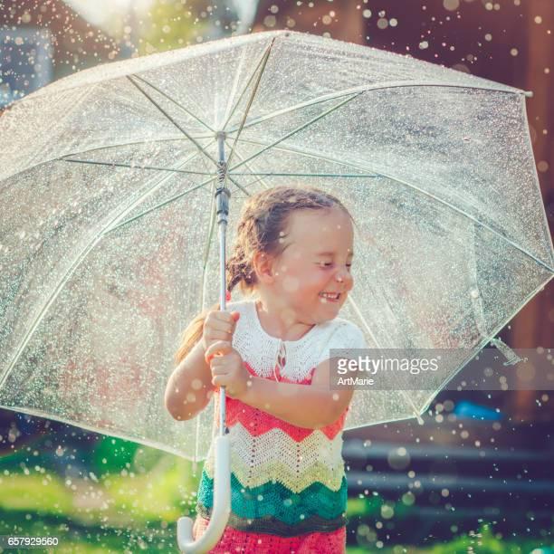 Happy girl in rain
