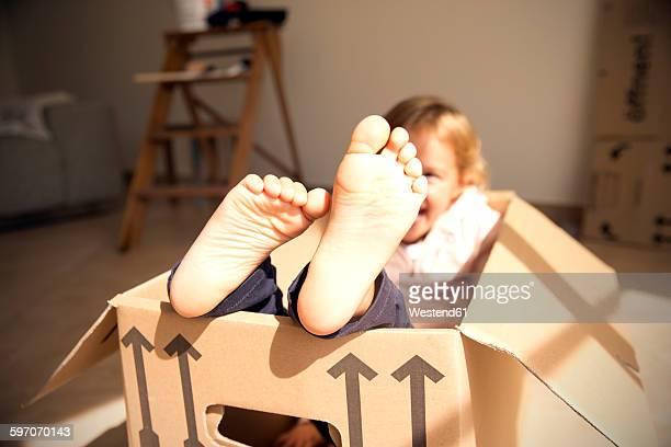 Happy girl inside cardboard box