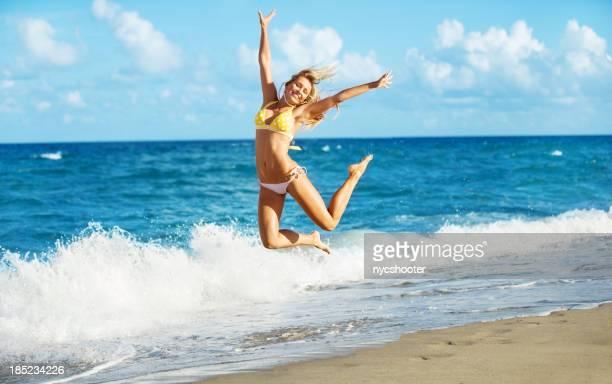 happy girl jumping at beach