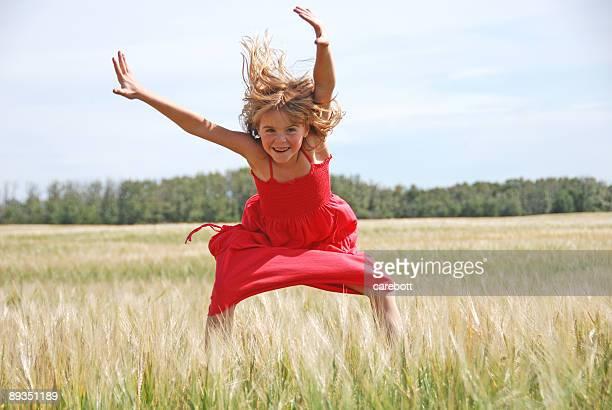 happy girl jumps for joy