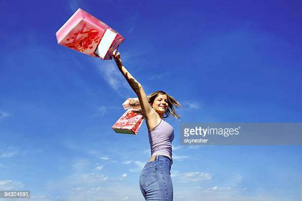 Happy girl outdoor with shopping bags