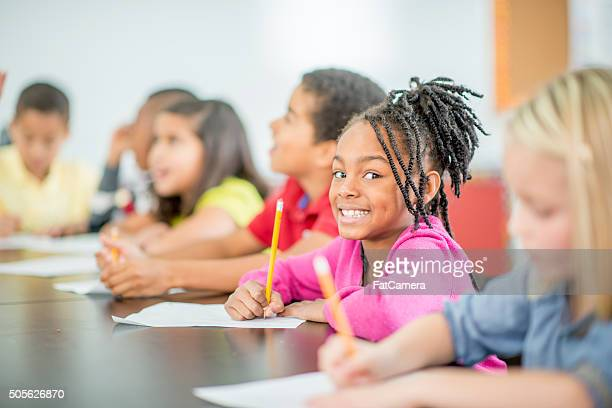 Happy Girl Sitting in Class