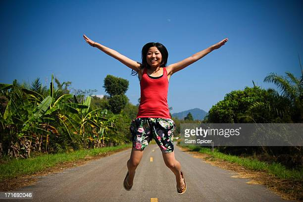 Happy girl star jump in Thailand