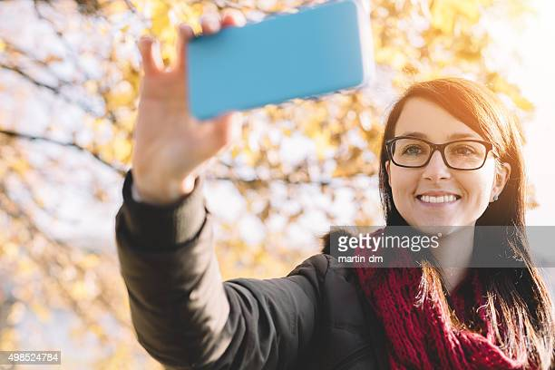 Happy girl taking a selfie among nature