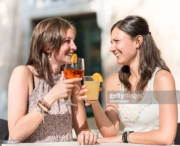Happy Girl toasting at bar