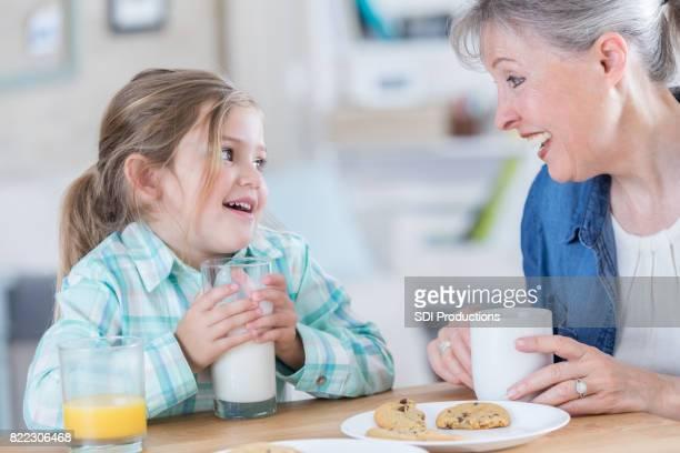Happy girl visits with grandma