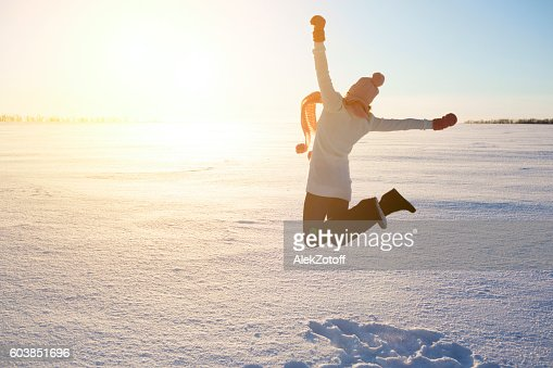 Happy girl with a red scarf on the winter : Stock Photo