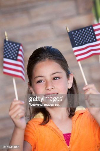 Happy girl with American flag : Stock Photo