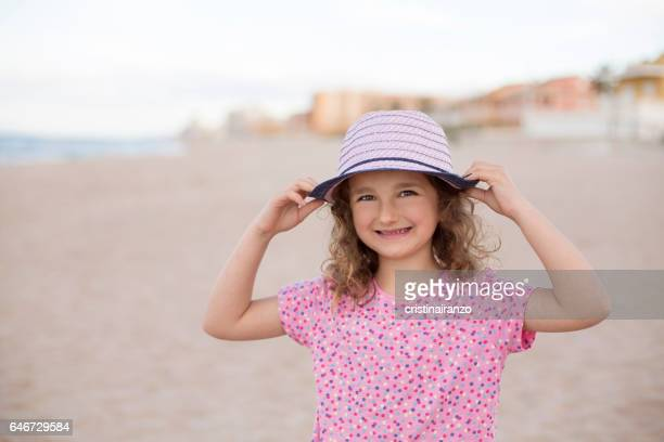Happy girl with pink hat