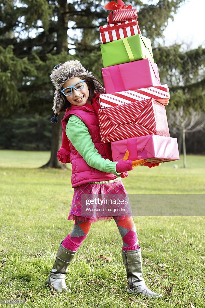 Happy girl with stack of gifts : Stock Photo