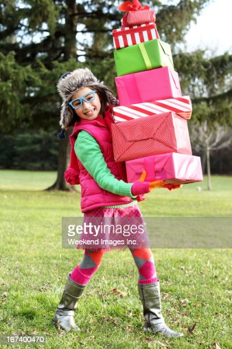 Happy girl with stack of gifts : Stockfoto