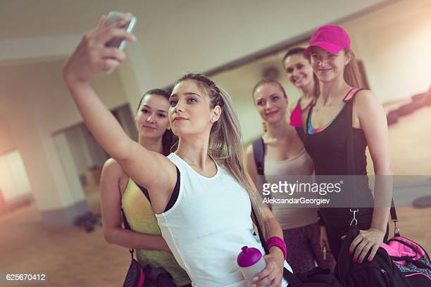 Happy Girlfriends Group Taking Selfie in Gym after Exercise