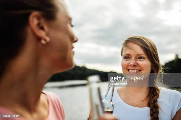 Happy girlfriends on a lake.