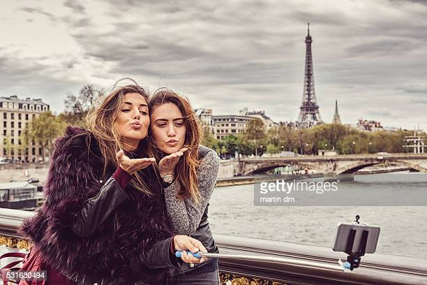 Happy girls in Paris taking selfie
