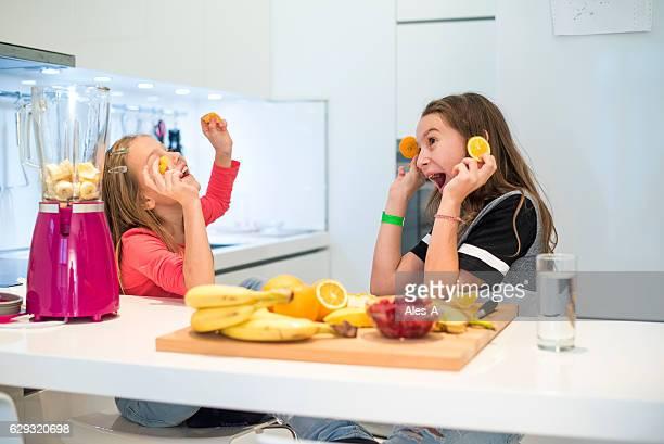 Happy girls in the kitchen