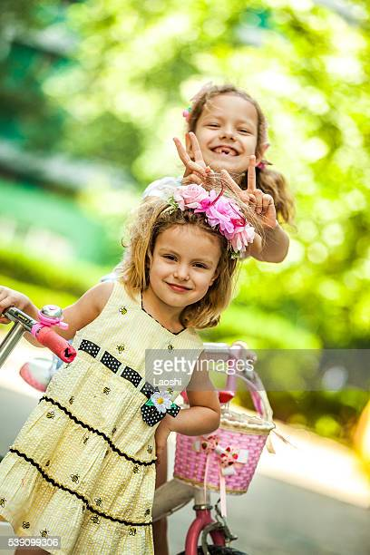 Happy Girls Riding Bikes