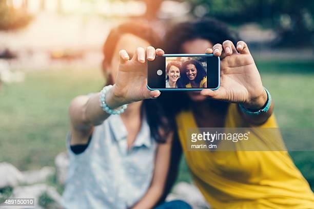 Happy girls taking a selfie