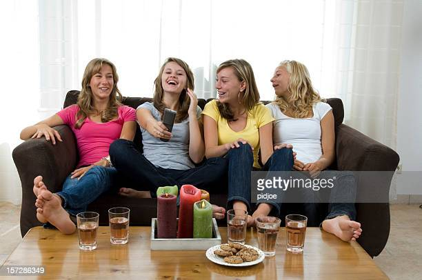 happy girls watching television