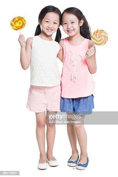 Happy girls with lollipops