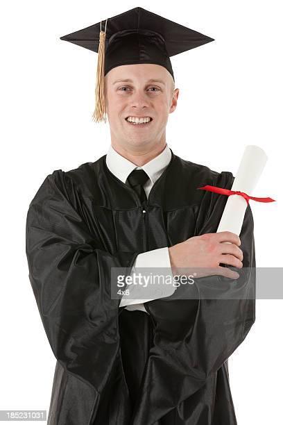 Happy graduate holding a graduation certificate
