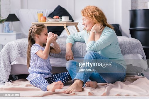Happy granddaughter taking photos of her grandmother : Stock Photo