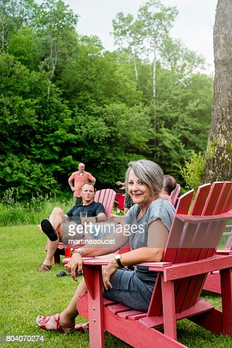 Happy grandmother having all her family relaxing in summer camping. : Stock Photo