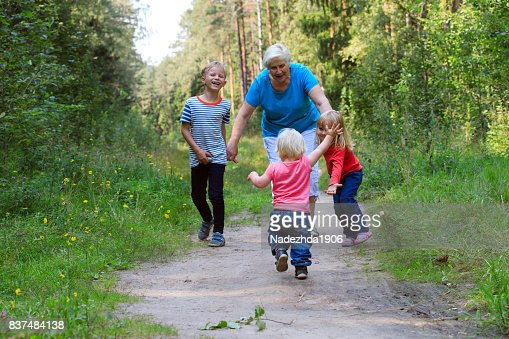 happy grandmother with kids play in nature : Stock Photo