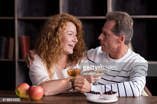 Happy grandparents drinking beverage : Stock Photo